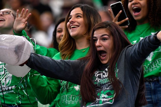 Hamlin senior Abby Cooper reacts Thursday after seeing herself on the giant screen at AT&T Stadium in Arlington. The Hamlin Pied Pipers played their first state championship game in the history of the program against Mart. Mart won the game 25-20 but Hamlin fans had plenty to cheer about.