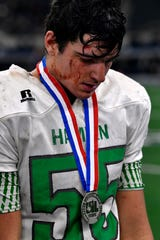 Hamlin's Ethan Byerly wears his medal after the Pied Pipers' loss to Mart during Thursday's Class 2A Div. II championship game. The blood on his face comes from a wound over his forehead that has reopened each time he played a game this season.
