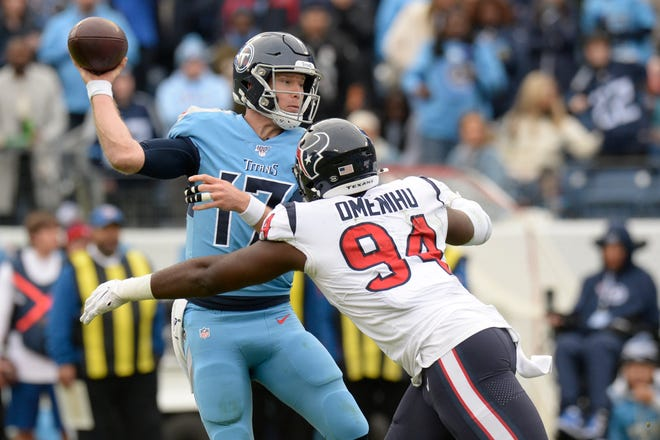 Tennessee Titans quarterback Ryan Tannehill (17) is pressured by Houston Texans defensive end Charles Omenihu (94) in the second half Sunday, Dec. 15, 2019, in Nashville, Tenn.