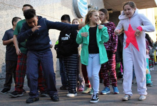 "Abilene ISD students makes their way to the Paramount Theatre for Wednesday's showing of ""The Polar Express."" Some wore their pajamas, making them the star of the show."