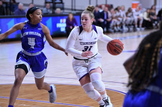 ACU's Madi Miller (31) drives into the lane against New Orleans in the Southland Conference opener at Moody Coliseum on Wednesday. Miller scored 11 points and pulled down eight boards off the bench as the Wildcats won 76-62.