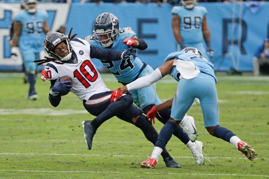Houston Texans wide receiver DeAndre Hopkins (10) is stopped by Tennessee Titans strong safety Kenny Vaccaro (24) in the second half Sunday, Dec. 15, 2019, in Nashville, Tenn.