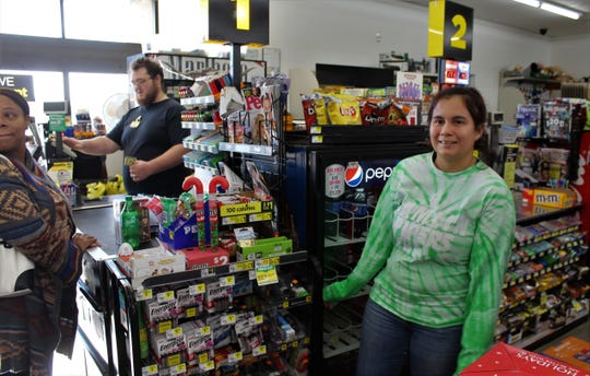 Dollar General manager Juanita Segovia, a 2015 Hamlin High graduate, wore her Hamlin Pipers T-shirt to work Thursday. There had been few customers; the woman at the left was from Rotan, where there is no Dollar General.