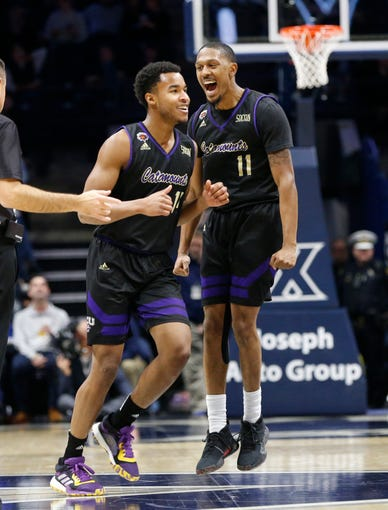Dec 18, 2019; Cincinnati, OH, USA; Western Carolina Catamounts guard Mason Faulkner (11) and guard Kameron Gibson (14) react during the second half against the Xavier Musketeers at the Cintas Center. Xavier won 74-61. Mandatory Credit: Frank Victores-USA TODAY Sports