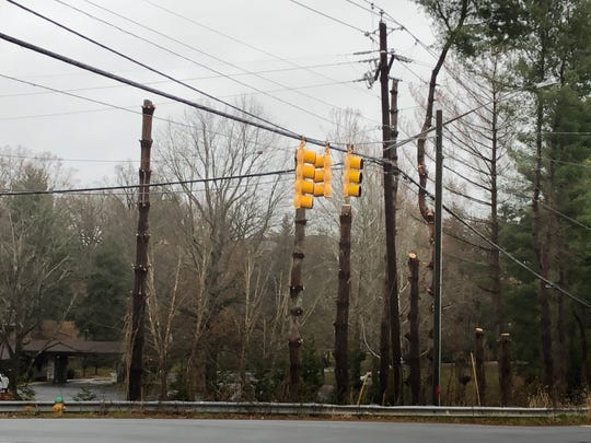 Duke Energy did have trees cut way back at the corner of Overlook and Hendersonville Roads in Arden recently. The N.C. DOT has a traffic flow project planned there that should start in mid-2020, and the trees will be completely removed at that time and the utility lines moved.
