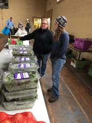 Jennifer West, assistant executive director at the Stecoah Valley Center talks with MANNA driver Keeka Grant as they set up for a Community Market. About 25 people came through the line, starting at 10 a.m. By 10:30, all the food was gone.