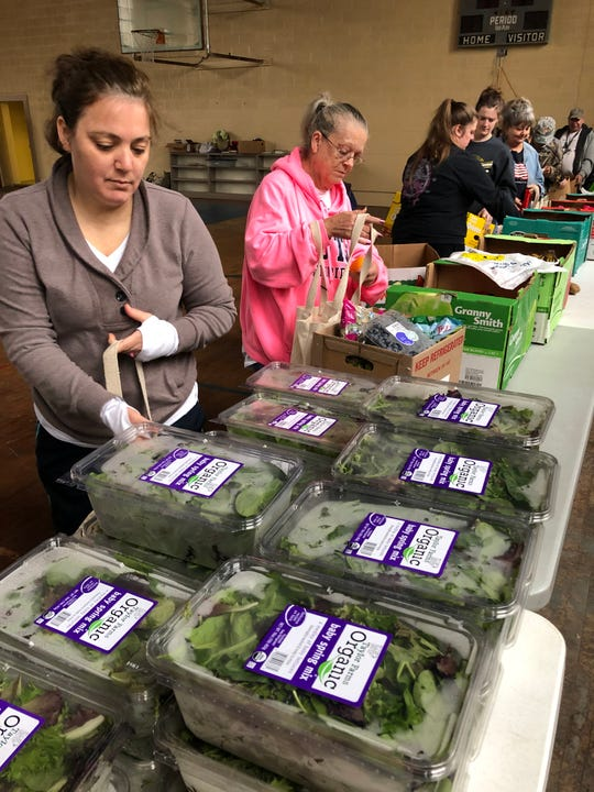 Tara Cody, left, and Mavis Cody check out fresh produce at MANNA FoodBank's Community Market in Graham County. Mavis Cody said being on a fixed income with Social Security, the food distribution really helps her stretch a dollar.