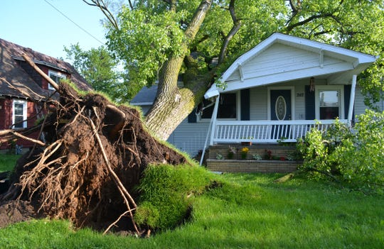 A tree fell on a house on Lakeview Avenue during the storm on May 29, 2011.