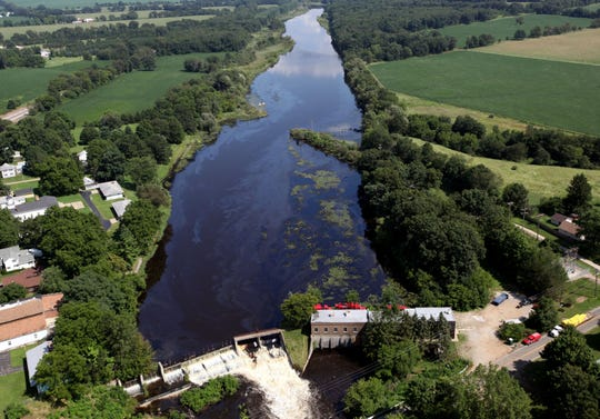 Oil and water flows down Ceresco Dam as oil spill cleanup continues along the Kalamazoo River in 2010 after a pipline owned by by Enbridge Inc. burst. The Environmental Protection Agency describes it as the costliest inland oil spill in U.S. history - and one of the largest.