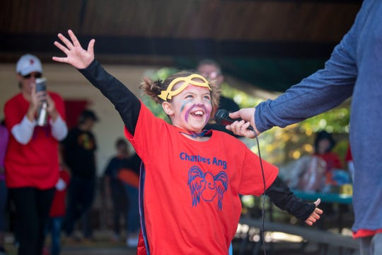Charlie Buckley, 9, announces the start of the Battle Creek NephCure Walk at Leila Arboretum on Sunday, Oct. 6, 2019. Charlie received a new kidney on May 22.