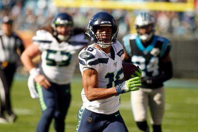 Seattle Seahawks wide receiver Tyler Lockett (16) runs the ball against the Carolina Panthers during the first half of and NFL football game in Charlotte, N.C., on Dec. 15, 2019.