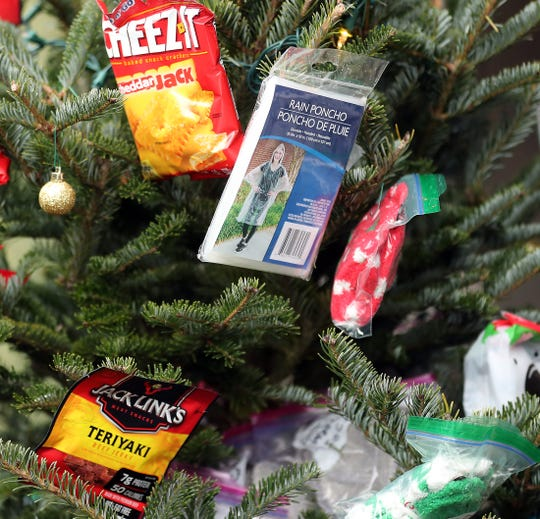 Small donated goods hang on the South Kitsap Football team tree in downtown Port Orchard.