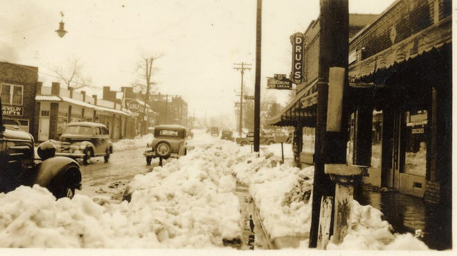 This photograph, thought to be taken after a March 17, 1936, snowstorm, looks west down State Street in Black Mountain