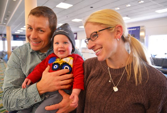 Little Owen Cole shows off his new Orlando Melbourne International Airport knit cap after he and his parents arrived on the inaugural daily nonstop flight from Philadelphia.