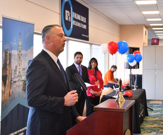 Orlando Melbourne International Airport Executive Director Greg Donovan welcomes passengers bound for Philadelphia during Thursday's ribbon-cutting event.