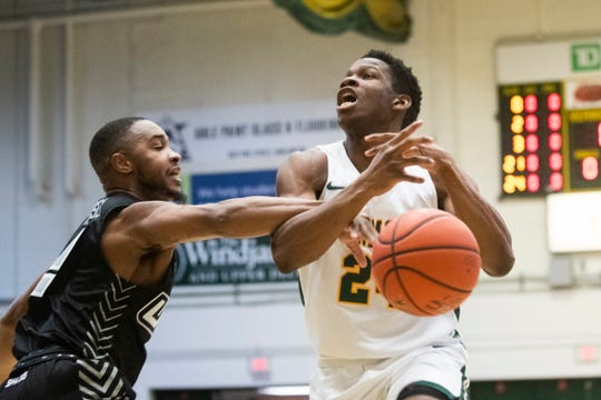 Vermont's Ben Shungu (24) is fouled by UNCG's Malik Massey (2) during the men's basketball game between the UNC Greensboro Spartans and the Vermont Catamounts at Patrick Gym on Wednesday night December 18, 2019 in Burlington, Vermont.