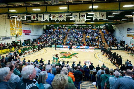 The teams listen to the National Anthem during the men's basketball game between the UNC Greensboro Spartans and the Vermont Catamounts at Patrick Gym on Wednesday night December 18, 2019 in Burlington, Vermont.