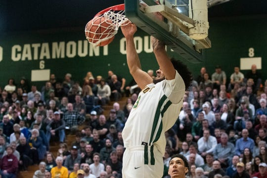 Vermont's Anthony Lamb (3) dunks the ball during the men's basketball game between the UNC Greensboro Spartans and the Vermont Catamounts at Patrick Gym on Wednesday night December 18, 2019 in Burlington, Vermont.