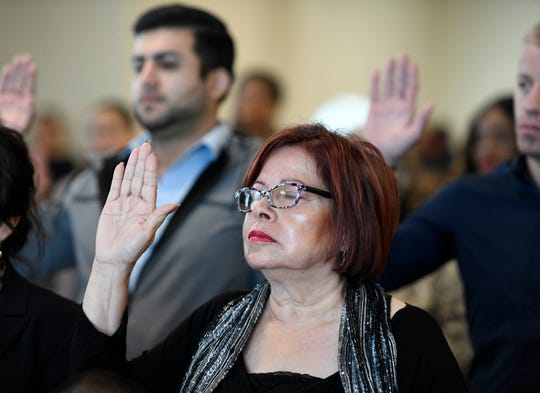 Rosa Elia Ramirez closes her eyes while she takes her Oath of Allegiance during her naturalization ceremony to become a U.S. citizen, Thursday, Dec. 19, 2019, at the U.S. District Court for the Southern District of Texas. Ramirez is originally from Mexico.