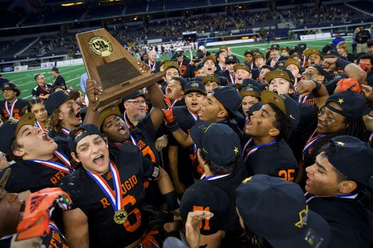 Refugio football players celebrate after winning the Class 2A Division I state championship on Wed. Dec. 18, 2019 at AT&T Stadium in Arlington, Texas.