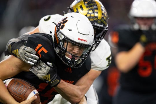 Refugio's quarterback Austin Ochoa runs he ball during the fourth quarter of the state championship game at AT&T Stadium in Arlington on Wednesday, Dec. 18, 2019.