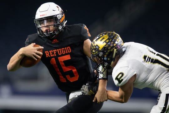 Refugio's quarterback Austin Ochoa is brought down by Post's Samuel Walls during the fourth quarter of the state championship game at AT&T Stadium in Arlington on Wednesday, Dec. 18, 2019.