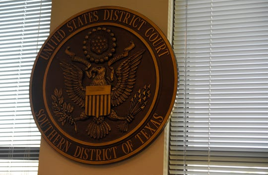 A seal is seen in the U.S. District Court for the Southern District of Texas. An Indian national pleaded guilty to defrauding U.S. citizens out of millions of dollars in an Indian-based call center scam.