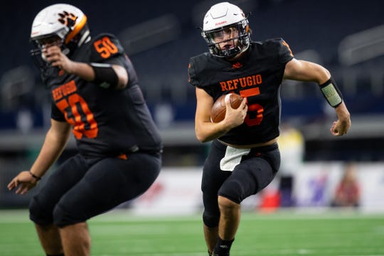 Refugio's quarterback Austin Ochoa runs the ball in for a touchdown during the second quarter of the start of the state championship game at AT&T Stadium in Arlington on Wednesday, Dec. 18, 2019.
