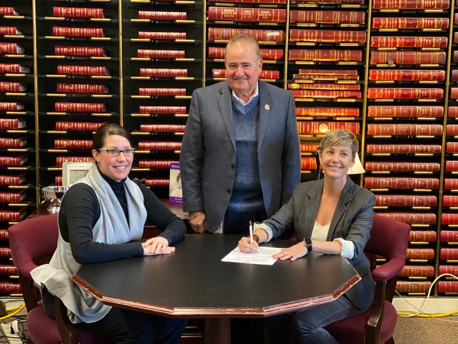 Rachel Roberts, right, signed her filing papers to run for in the House District 67 special election. Former rep. Dennis Keene and Secretary of State Allison Grimes witnessed Roberts make her campaign official.