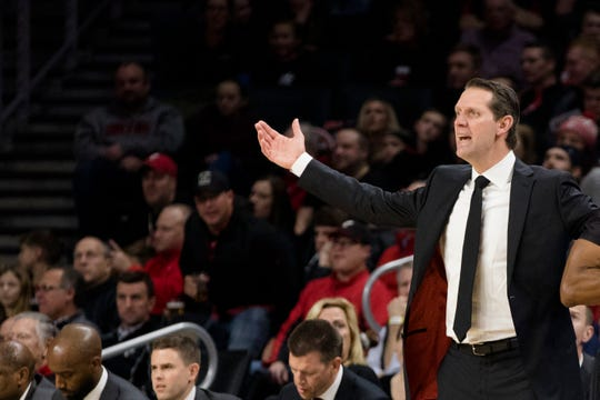 Cincinnati Bearcats head coach John Brannen reacts to a chargrills call in the first half of the NCAA Basketball game between Cincinnati Bearcats and Tennessee Volunteers on Wednesday, Dec. 18, 2019, at Fifth Third Arena at the University of Cincinnati in Cincinnati.