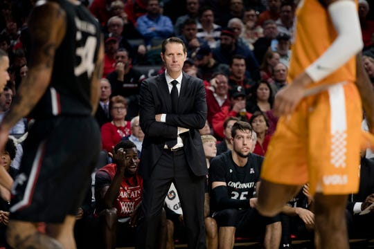 Cincinnati Bearcats head coach John Brannen smiles in the second half of the NCAA Basketball game on Wednesday, Dec. 18, 2019, at Fifth Third Arena at the University of Cincinnati in Cincinnati. Cincinnati Bearcats defeated Tennessee Volunteers 78-66.