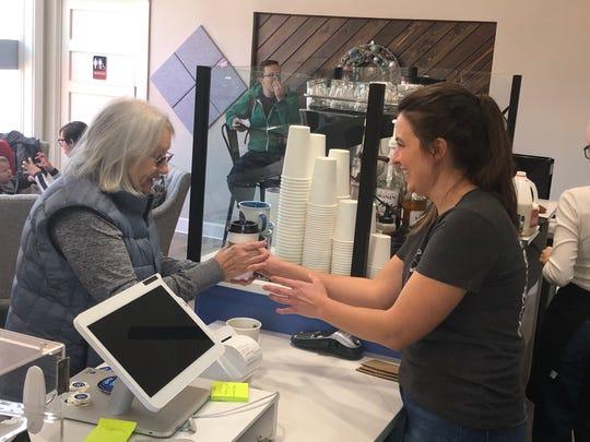 Co-owner Ellen Gerard serves a customer Thursday at Sayler Park Coffee Shop.