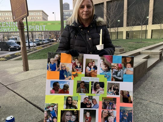 Stroup's aunt, Angela Velasquez, holds photos of Stroup with her sons.
