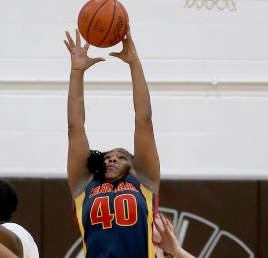 Purcell Marian forward Jariah McCrory (40) rebounds the ball during their basketball game against Roger Bacon, Wednesday, Dec. 18, 2019.