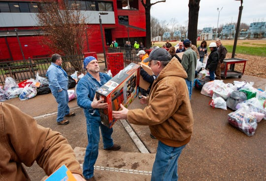 Cumberland Fossil Plant employees load a box trailer full of Christmas presents for more than 250 children living in the Houston, Stewart and Humphreys County region.