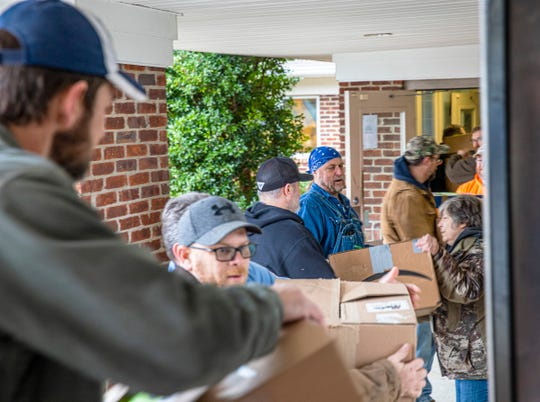 Outside the Highland Rim Head Start in Erin, Tennessee, TVA employees deliver Angel Tree presents for more than 250 children living in Houston, Stewart, and Humphreys County region.
