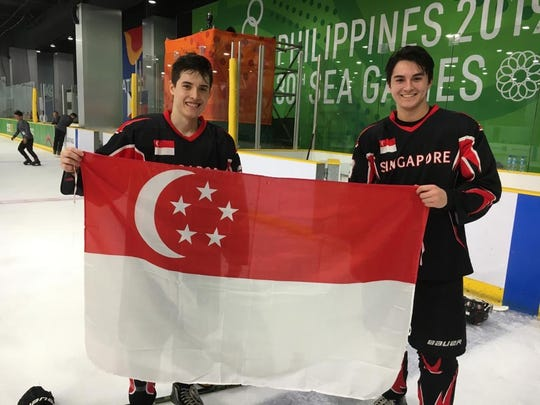 Christian and Ethan Redden celebrate after winning the Silver Medal at the South East Asia (SEA) Games 2019.