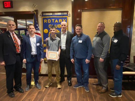 Ronan Tubridy (third from left), with Rotarian members, won the Rotary Club of Branchburg essay contest for December.