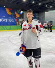 RVCC student Christian Redden displays the Silver Medal he received as a member of Singapore's National Ice Hockey Team, competing at the South East Asia (SEA) Games 2019.