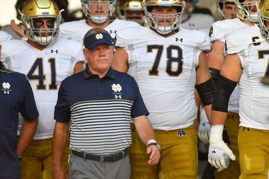Sep 2, 2019; Louisville, KY, USA; Notre Dame Fighting Irish head coach Brian Kelly leads his players onto the field before the game against the Louisville Cardinals at Cardinal Stadium. Mandatory Credit: Matt Cashore-USA TODAY Sports