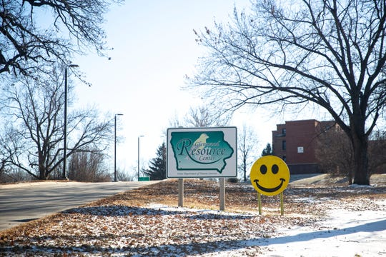 A sign with a smiling face greets drivers as they enter the Glenwood Resource Center campus on Wednesday, Dec. 19, 2019, in Glenwood.