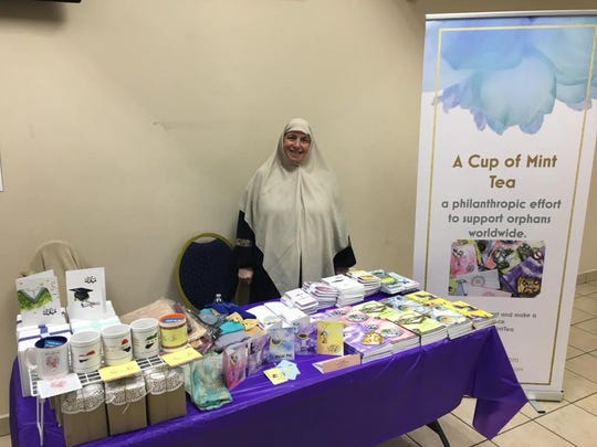 "Iman Jasim sells her book, ""A Cup of Mint Tea"" to raise money for orphans worldwide."