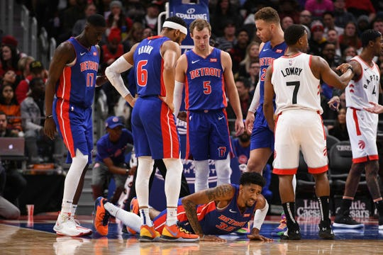 Detroit Pistons forward Christian Wood reacts after injuring his knee during the second quarter against the Toronto Raptors at Little Caesars Arena, Dec. 18, 2019, in Detroit.