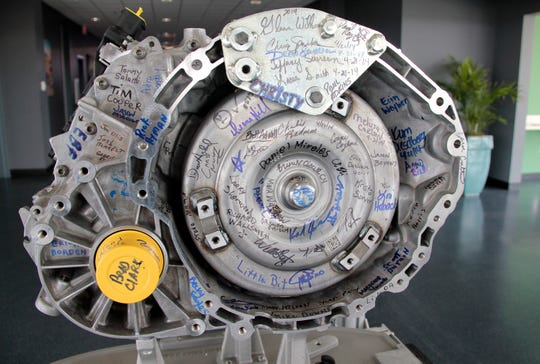 The first nine-speed transmission built at the Tipton Transmission Plant in Indiana is signed by employees. The nine-speed transmissions were used in Jeep Cherokees.