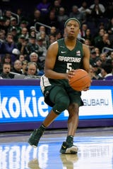 Michigan State guard Cassius Winston prepares to shoot against Northwestern at Welsh-Ryan Arena, Dec. 18, 2019.