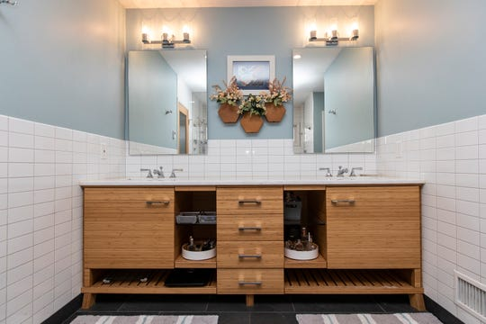 Bedroom, bath and closets were completely remade in the main floor owners' suite. Here the bathroom cabinets and two sinks have been rebuilt with contemporary bamboo in the same spirit as the original oak.