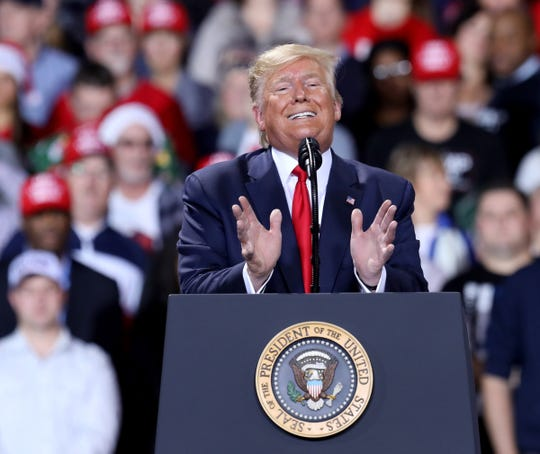 President Trump talks during the Merry Christmas Rally at Kellogg Arena in Battle Creek, Michigan on Wednesday, December 18, 2019.