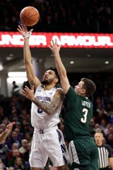 Northwestern's Boo Buie shoots against Michigan State's Foster Loyer during the second half  Wednesday, Dec. 18, 2019, in Evanston, Ill.