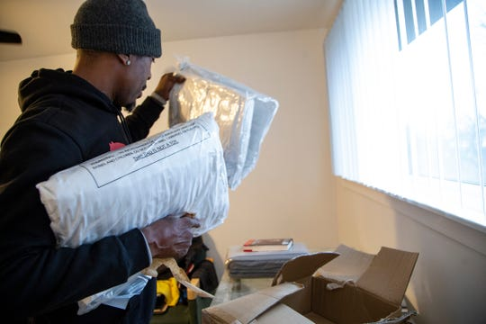 Exonerated prisoner, James Clay, starts to get settled into his new residence in Detroit Thursday Dec. 5, 2019.