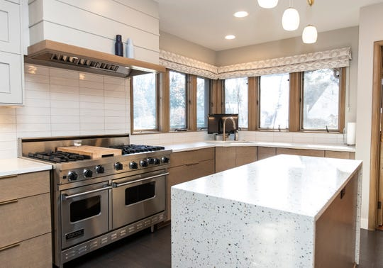 Redesigned kitchen brings a new layout, but imitates the original with maple cabinets finished to mimic the limed oak. Counters are quartz. Appliances are all Wolf.